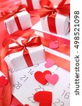 gifts with red ribbons | Shutterstock . vector #498521098
