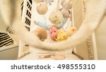baby lying in his cot and... | Shutterstock . vector #498555310
