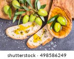 olive oil and fresh branch of... | Shutterstock . vector #498586249