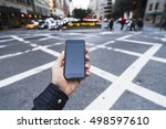 man holding a phone in the city. | Shutterstock . vector #498597610