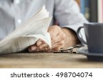 man newspaper reading on table | Shutterstock . vector #498704074