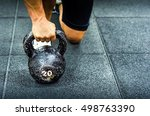 muscular woman holding old and... | Shutterstock . vector #498763390
