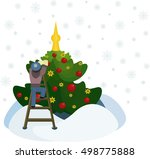 the boy decorates a christmas... | Shutterstock .eps vector #498775888