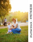 mother and daughter in park | Shutterstock . vector #498783838