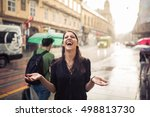 woman stands under the rain... | Shutterstock . vector #498813730