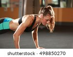 fitness woman doing push ups in ... | Shutterstock . vector #498850270