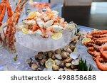 fresh alaska king crab on ice   ... | Shutterstock . vector #498858688