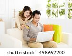 young  couple  shopping online... | Shutterstock . vector #498962200