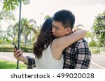 cheater texting with his other... | Shutterstock . vector #499020028