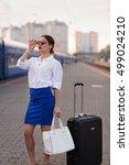 pretty business woman waiting... | Shutterstock . vector #499024210