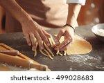 man preparing pasta on kitchen...   Shutterstock . vector #499028683