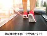 legs of sporty woman running on ... | Shutterstock . vector #499064344