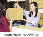 young female asian salesclerk... | Shutterstock . vector #499095313