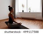 young woman meditating indoors. ... | Shutterstock . vector #499117588
