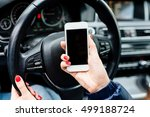 woman in car holding a white... | Shutterstock . vector #499188724
