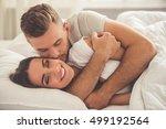 handsome young man is hugging... | Shutterstock . vector #499192564