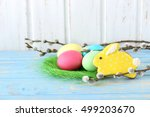 Easter Eggs On A Blue Wooden...