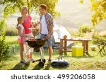 smiling parent grilling meat... | Shutterstock . vector #499206058