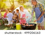 smiling grandfather giving... | Shutterstock . vector #499206163