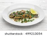 Small photo of trout meuniere amandine, rainbow trout with brown butter and almonds