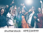 Stock photo fun is all they need today group of beautiful young people dancing with champagne flutes and 499234999