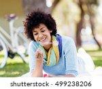 beautiful woman blowing bubbles ... | Shutterstock . vector #499238206