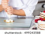 cream filling pastry chef on a...   Shutterstock . vector #499243588