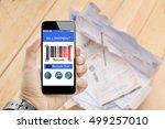 man holding smart phone online... | Shutterstock . vector #499257010