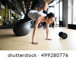 athletic woman exercising with... | Shutterstock . vector #499280776