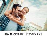 man giving piggyback ride to... | Shutterstock . vector #499303684