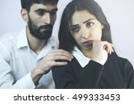 men pleading at his girlfriend... | Shutterstock . vector #499333453