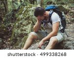 tired man traveler in wild... | Shutterstock . vector #499338268