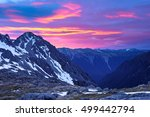Small photo of A Colorful Sunrise Illuminates Snowy Mountains. Nelson Lakes National Park, Southern Alps, New Zealand