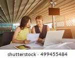 two professional economists... | Shutterstock . vector #499455484