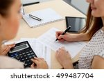 two female accountants counting ... | Shutterstock . vector #499487704