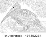 Stylized pelican bird among foliage. Freehand sketch for adult anti stress coloring book page with doodle and zentangle elements.