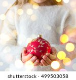 child holding red christmas ball | Shutterstock . vector #499503058
