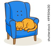 A Cat Sitting In An Armchair....