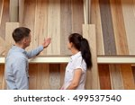 couple looking at parquet board ... | Shutterstock . vector #499537540