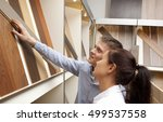 couple looking at parquet board ... | Shutterstock . vector #499537558