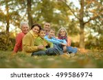 family relaxing in autumn park | Shutterstock . vector #499586974