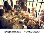 people celebrating thanksgiving ... | Shutterstock . vector #499592020