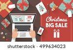 man purchasing christmas gifts... | Shutterstock .eps vector #499634023