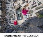 Little Boy And Girl Climbing...