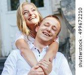 cheerful blonde hugs her man... | Shutterstock . vector #499672210