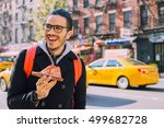 man eating a pizza slice in new ... | Shutterstock . vector #499682728