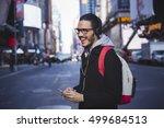man walking in new york with... | Shutterstock . vector #499684513