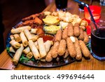 silver plate full of appetizers ... | Shutterstock . vector #499694644