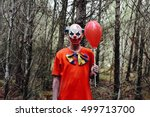 A Scary Evil Clown Wearing A...