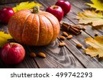 wood background with pumpkin ... | Shutterstock . vector #499742293
